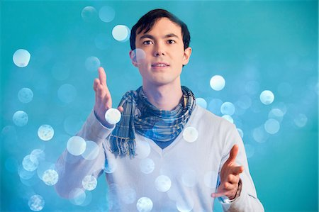 Portrait of young man wearing blue jumper and scarf Stock Photo - Premium Royalty-Free, Code: 614-06896860