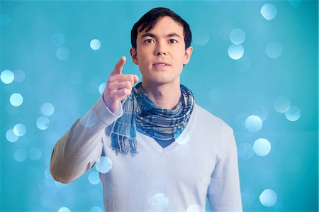 sparkling - Portrait of young man wearing blue jumper and scarf Stock Photo - Premium Royalty-Free, Code: 614-06896861