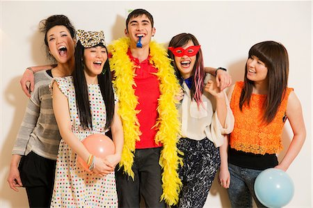 party - Friends at a party with balloons, studio shot Stock Photo - Premium Royalty-Free, Code: 614-06896887