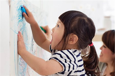 drawing - Close up portrait of female toddler having fun drawing Stock Photo - Premium Royalty-Free, Code: 614-06896945