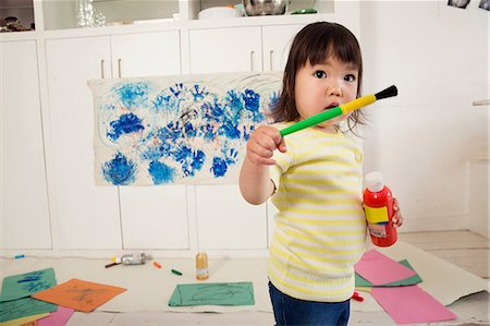 draw - Female toddler holding paint bottle and brush Stock Photo - Premium Royalty-Free, Code: 614-06896955
