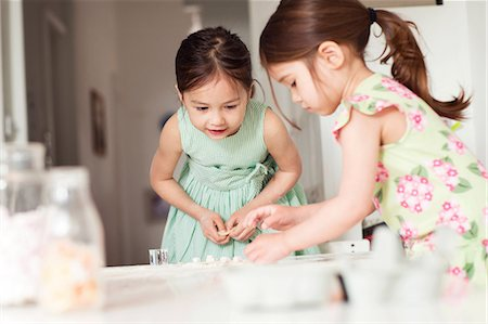 Two young sisters making pastry Stock Photo - Premium Royalty-Free, Code: 614-06896965
