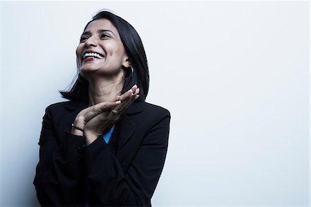 Studio portrait of businesswoman smiling Stock Photo - Premium Royalty-Free, Code: 614-06897223