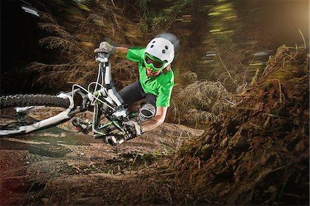 Mountain biker riding narrow track Stock Photo - Premium Royalty-Free, Code: 614-06897290