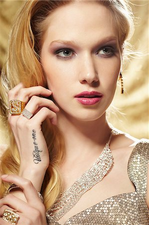 expensive jewelry - Close up portrait of young woman with hand tattoo Stock Photo - Premium Royalty-Free, Code: 614-06897309