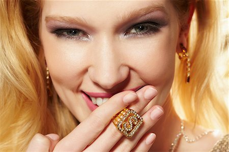 expensive jewelry - Close up portrait of young woman wearing diamond signet ring Stock Photo - Premium Royalty-Free, Code: 614-06897315