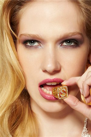 pretty - Portrait of young woman with diamond ring in her mouth Stock Photo - Premium Royalty-Free, Code: 614-06897313