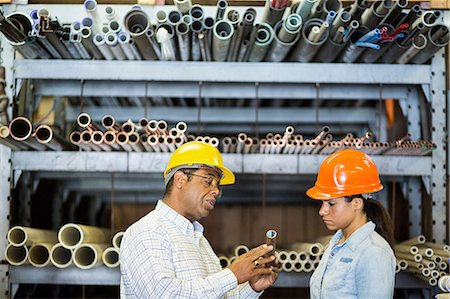 pipe (industry) - Two warehouse workers looking at copper pipe Stock Photo - Premium Royalty-Free, Code: 614-06897362