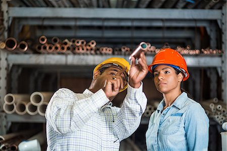 pipe (industry) - Two warehouse workers looking at copper pipe Stock Photo - Premium Royalty-Free, Code: 614-06897363
