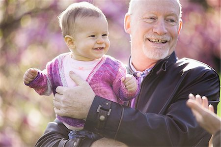 playing - Close up portrait of baby girl and grandfather Stock Photo - Premium Royalty-Free, Code: 614-06897396