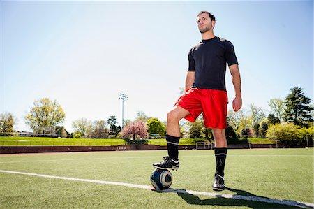 footballeur - Soccer player preparing for free kick Stock Photo - Premium Royalty-Free, Code: 614-06897429