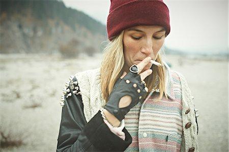 Woman smoking Stock Photo - Premium Royalty-Free, Code: 614-06897508
