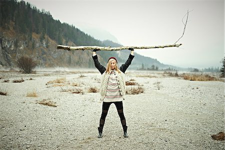 Woman holding log Stock Photo - Premium Royalty-Free, Code: 614-06897516