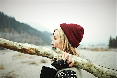 Woman holding log Stock Photo - Premium Royalty-Free, Code: 614-06897522
