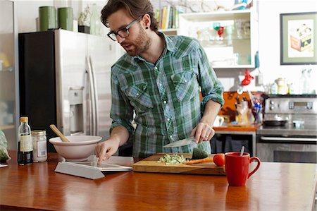 Man chopping vegetables Stock Photo - Premium Royalty-Free, Code: 614-06897564