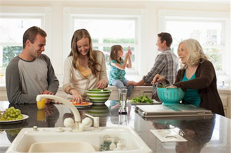 Three generation family in kitchen preparing food Stock Photo - Premium Royalty-Free, Code: 614-06897647