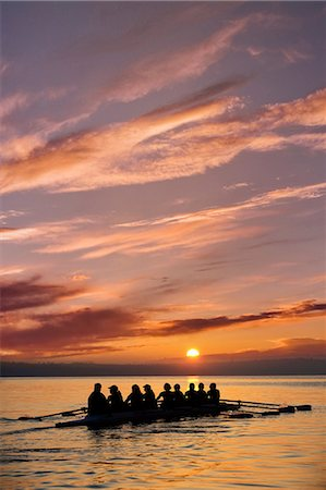 sport rowing teamwork - Eight people rowing at sunset Stock Photo - Premium Royalty-Free, Code: 614-06897796