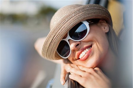 dark glasses - Mature woman wearing sunglasses and sunhat Stock Photo - Premium Royalty-Free, Code: 614-06897790
