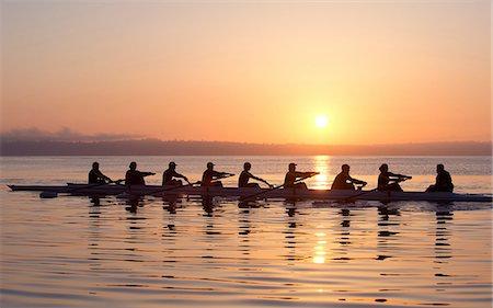 sport rowing teamwork - Nine people rowing at sunset Stock Photo - Premium Royalty-Free, Code: 614-06897801