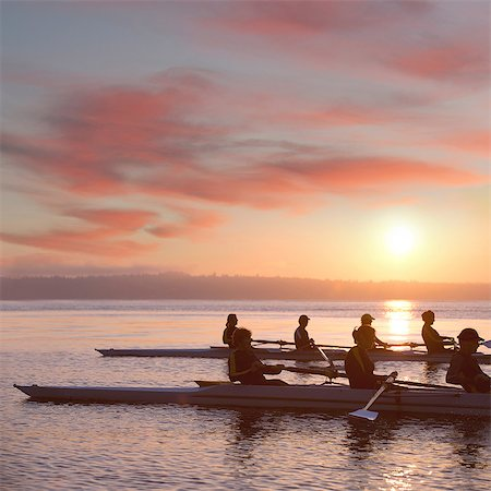 sport rowing teamwork - Seven people rowing at sunset Stock Photo - Premium Royalty-Free, Code: 614-06897802