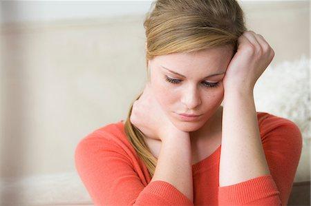 Sad teenage girl with hand on head Stock Photo - Premium Royalty-Free, Code: 614-06897811