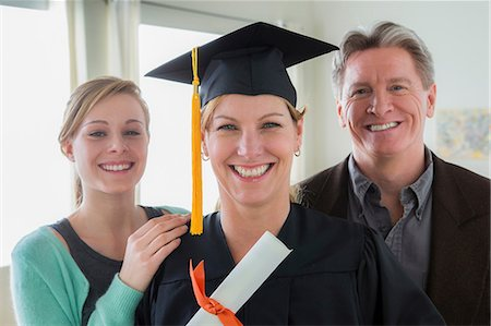 Mother wearing mortarboard with daughter and husband Stock Photo - Premium Royalty-Free, Code: 614-06897831