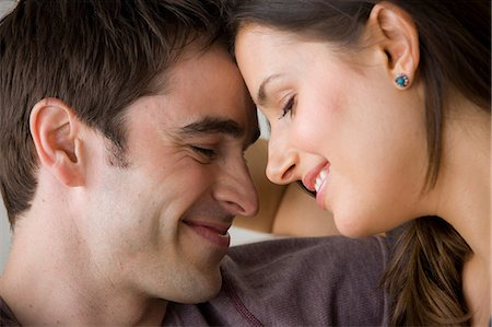 smiling - Couple face to face, close up Stock Photo - Premium Royalty-Free, Code: 614-06897915