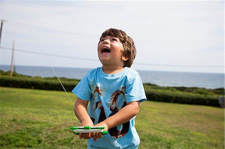 Boy flying kite Stock Photo - Premium Royalty-Free, Code: 614-06898007
