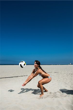 Female beach volleyball player digging ball Stock Photo - Premium Royalty-Free, Code: 614-06898040