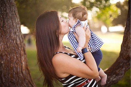daughter kissing mother - Portrait of mother kissing baby daughter Stock Photo - Premium Royalty-Free, Code: 614-06898061