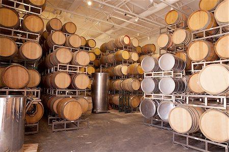 Wooden wine barrels in vineyard Stock Photo - Premium Royalty-Free, Code: 614-06898073