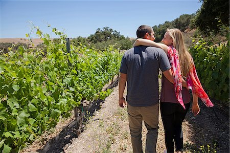 Young couple on path in vineyard, woman with arm around man Stock Photo - Premium Royalty-Free, Code: 614-06898128