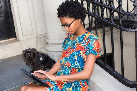 Woman using digital tablet Stock Photo - Premium Royalty-Free, Code: 614-06898144