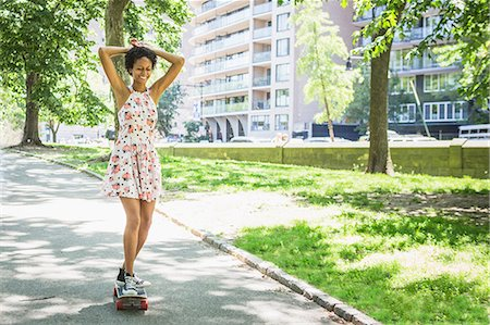 Woman skateboarding Stock Photo - Premium Royalty-Free, Code: 614-06898154