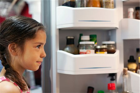 fridge - Girl looking into fridge Stock Photo - Premium Royalty-Free, Code: 614-06898164