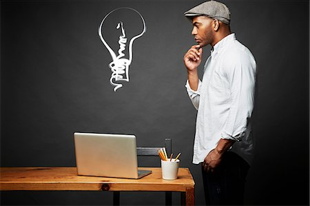 Man looking for an idea Stock Photo - Premium Royalty-Free, Code: 614-06898189