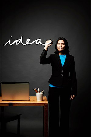 Woman writing down idea Stock Photo - Premium Royalty-Free, Code: 614-06898198