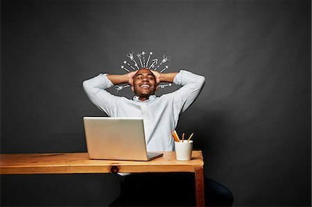 exploding - Man laughing with explosion of ideas Stock Photo - Premium Royalty-Free, Code: 614-06898193