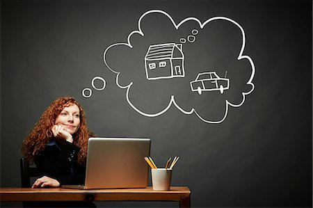 Woman dreaming of new house and car Stock Photo - Premium Royalty-Free, Code: 614-06898240