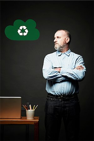 Man looking at environmental issue Stock Photo - Premium Royalty-Free, Code: 614-06898242