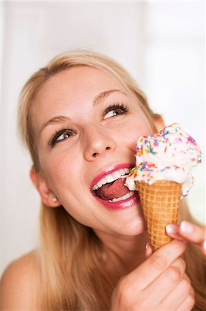 Woman licking ice cream Stock Photo - Premium Royalty-Free, Code: 614-06898254