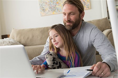 Father with child using laptop Stock Photo - Premium Royalty-Free, Code: 614-06898292