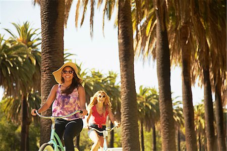 palm - Women on bicycle laughing Stock Photo - Premium Royalty-Free, Code: 614-06898326