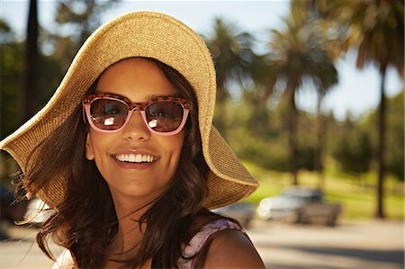 dark glasses - Woman with hat and sunglasses Stock Photo - Premium Royalty-Free, Code: 614-06898320