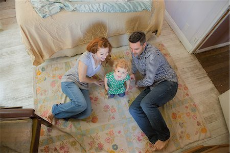 Couple lying on floor with child Stock Photo - Premium Royalty-Free, Code: 614-06898411
