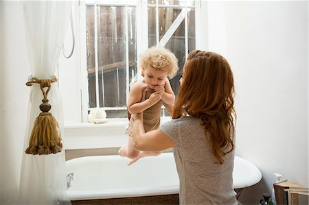 Mother lifting child from bathtub Stock Photo - Premium Royalty-Free, Code: 614-06898425
