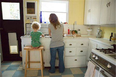 Mother and child at kitchen sink Stock Photo - Premium Royalty-Free, Code: 614-06898426