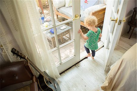 Toddler going onto verandah Stock Photo - Premium Royalty-Free, Code: 614-06898437