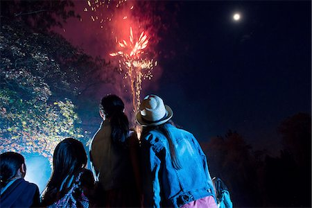 People watching fireworks display Stock Photo - Premium Royalty-Free, Code: 614-06898440
