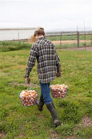 farming (raising livestock) - Boy carrying two baskets of eggs Stock Photo - Premium Royalty-Free, Code: 614-06898461